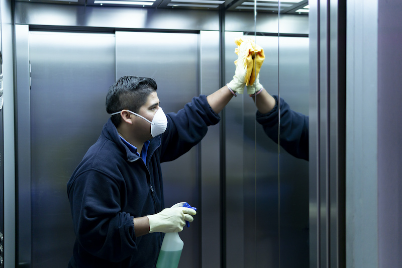 Elevator cleaning with microfiber cloth